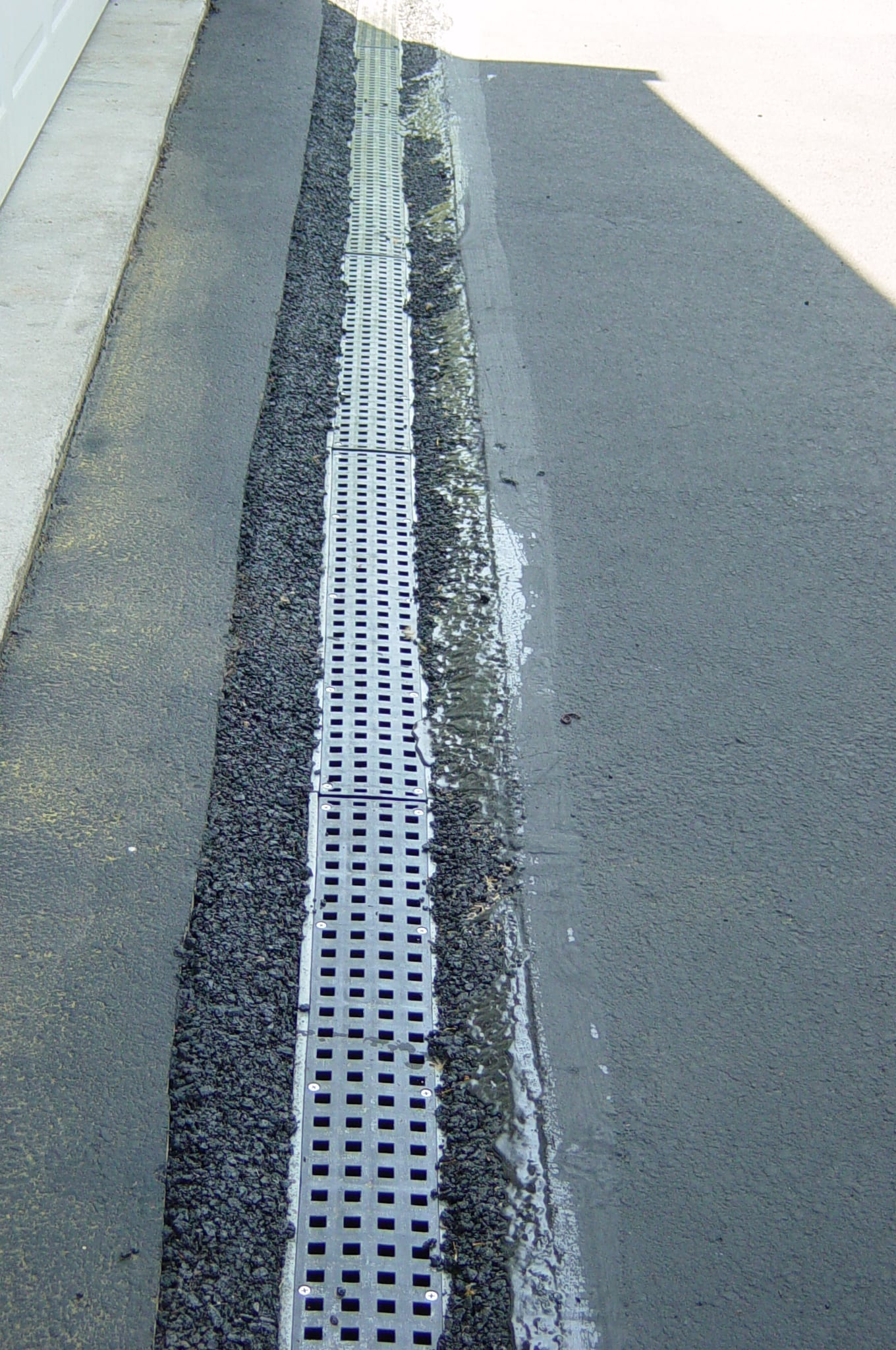 3 reasons why trench drains fail plastic trench drain asphalt trench drain install trench drain in asphalt drain in asphalt driveway solutioingenieria Images